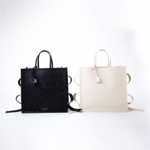 Collection of OCTOPUS SHOPPER Bag, a party bag with minimalist look and available in cream and embossed black variants