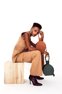 Photoshoot with ATENA GREEN PURSE-SLING BAG, a green bag, handbag with minimalist look from MDLR