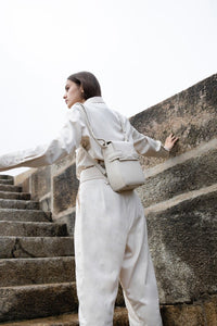 A woman in white with OCTAVIO RIS 4 WAY BACKPACK, a cute cream backpack with fashionable look and feel by MDLR