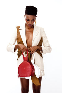 A photoshoot of ATENA ROSSO LIZARD PURSE-SLING BAG, a hot red bag, hot red purse, with lizard look from MDLR