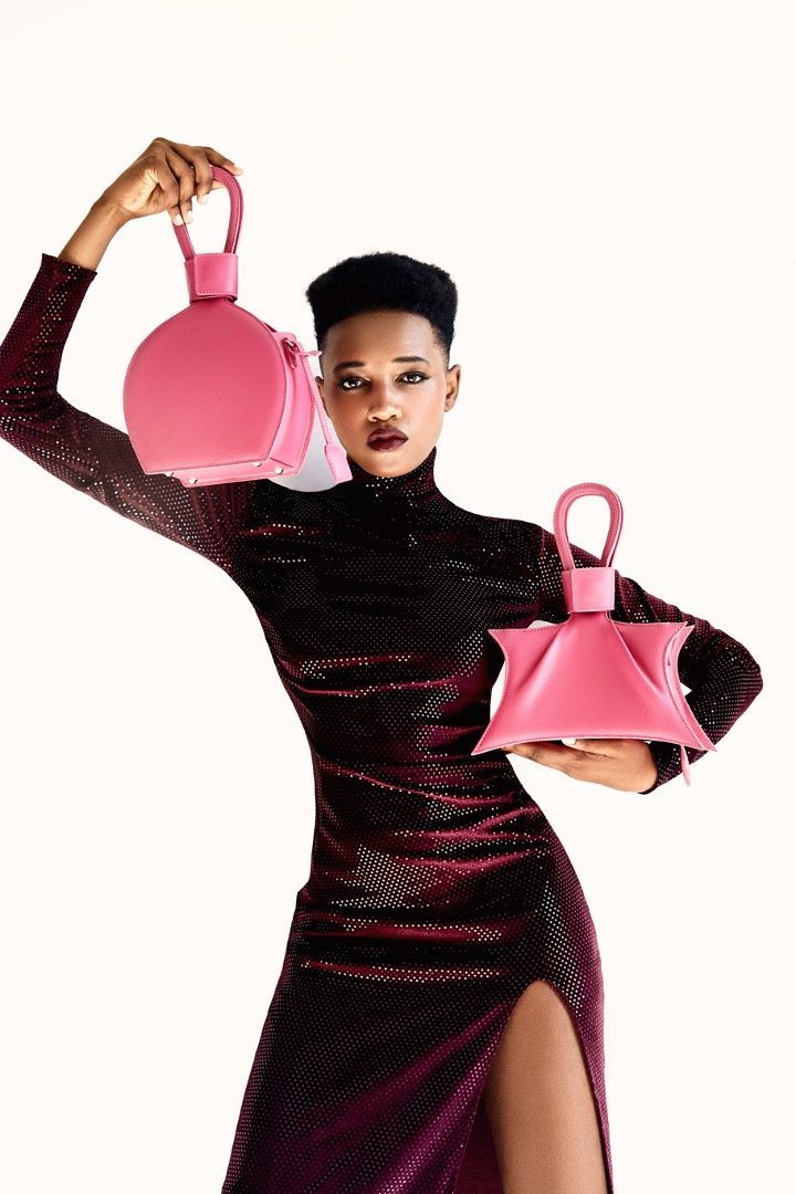 A photoshoot with ATENA PASSION PURSE-SLING BAG, a hot pink bag, hot pink purse, with minimalist look from MDLR