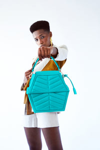 CEASAR CERULEAN IN CROSSOVER PADDING HANDBAG
