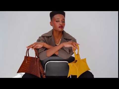 A studio video shoot with MICRO BLANKET WHISKEY CROC is a micro brown bag, small bag with a croc look from MDLR