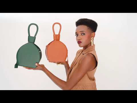 Studio videoshoot of ATENA GREEN PURSE-SLING BAG, a green bag, green purse, with minimalist look from MDLR