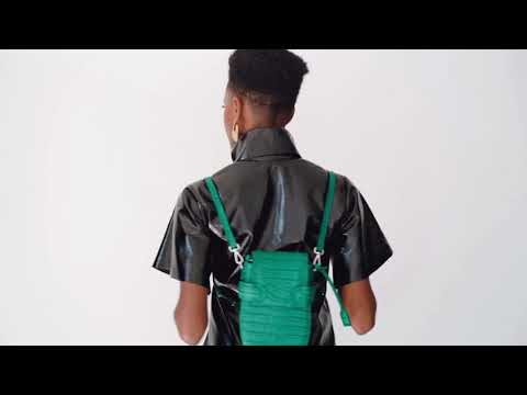 A studio videoshoot for OCTAVIO EMERALD CROC 4 WAY BACKPACK, a cute green backpack with croc look and feel by MDLR