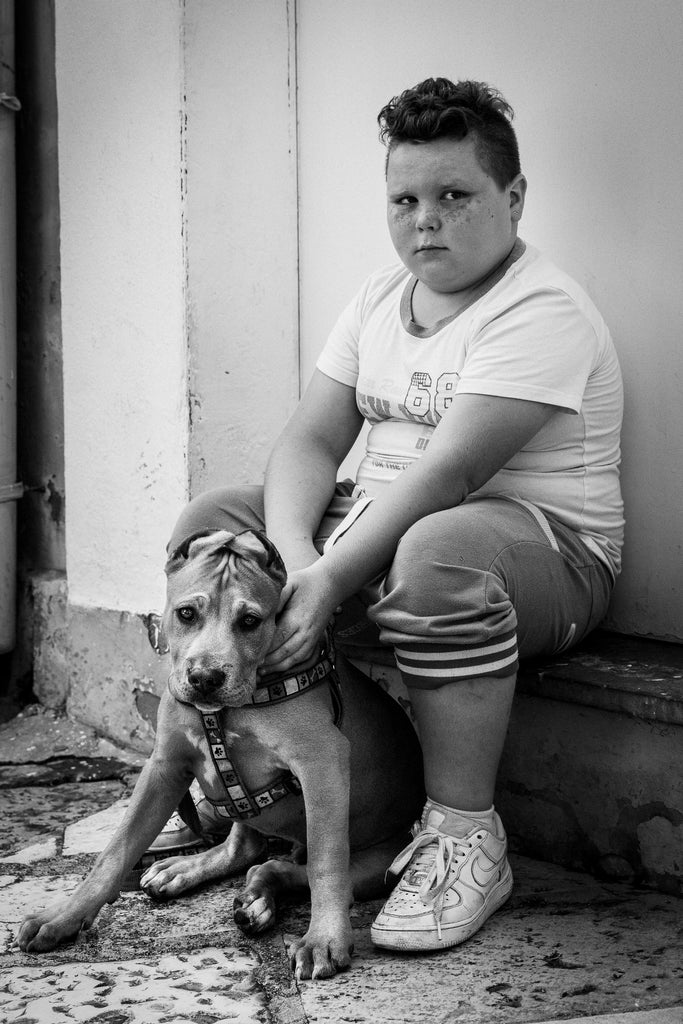 A BOY'S OWN DREAM.  This little boy, with his adorable freckles and his puppy, live in the beautiful and historic Old Town of Bari (Bari Vecchia) in Puglia. Of course I couldn't resist taking this photograph. His mother came out and told him to, 'Stay there for the nice lady!' And so he did but was not a happy camper till later, when he saw himself in the back of the camera. Then he went off and continued playing with his puppy. Limited Edition Fine Art print.