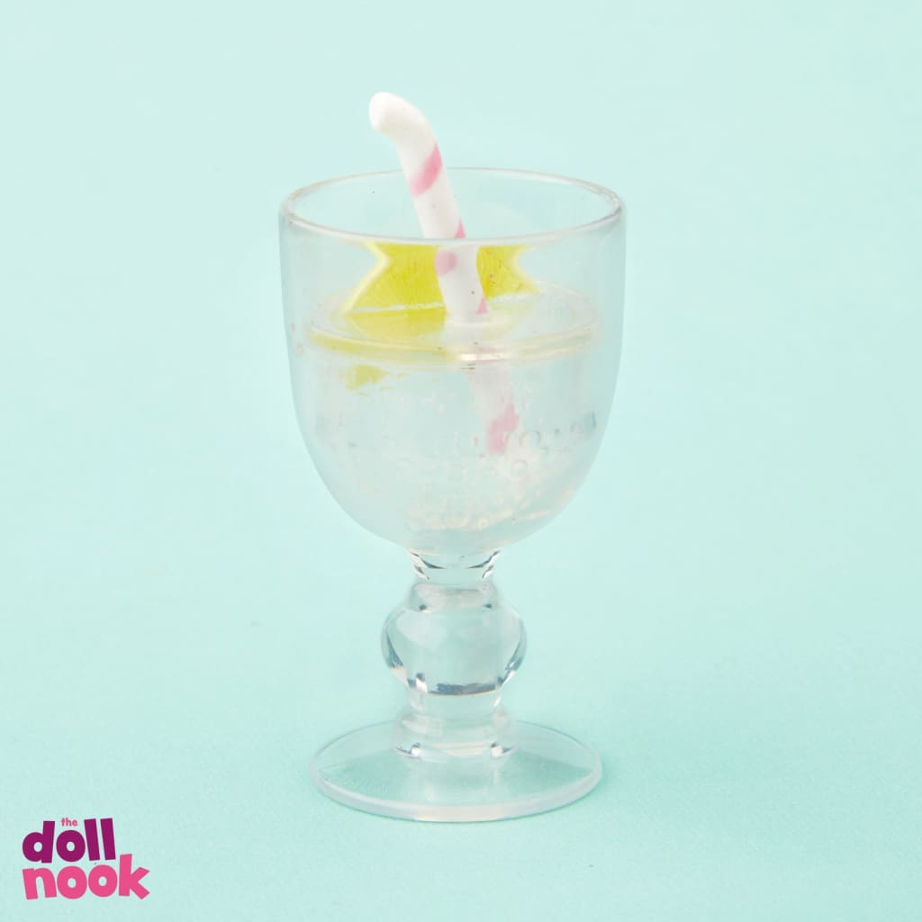 American Girl, stem glass with pink and white straw and slice of lemon inside, from Blaire's farmhouse restaurant