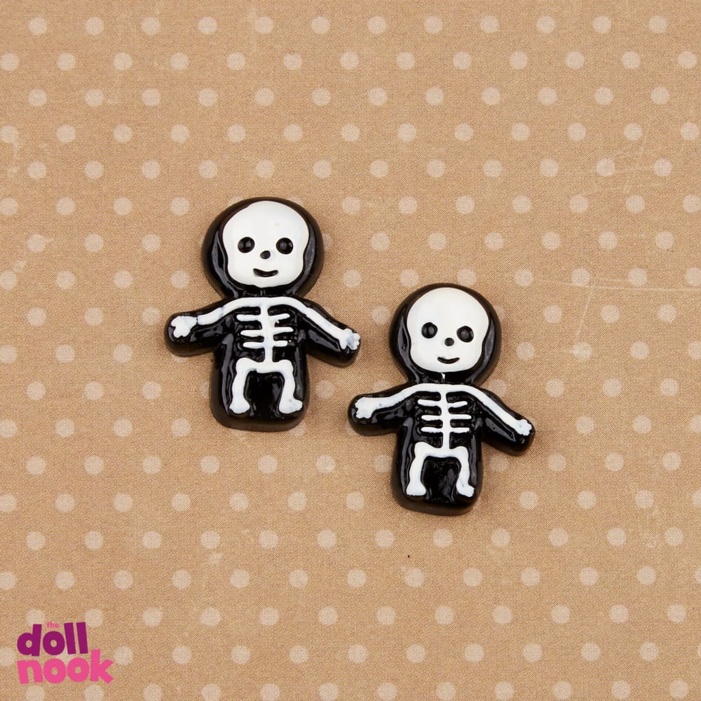 "2 resin skeleton chocolates, 18"" doll food"