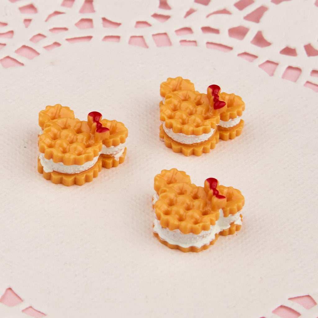 3 resin mickey waffles, whip cream sandwiched between 2 mickey shaped waffles, red bow decoration, 18 inch doll food