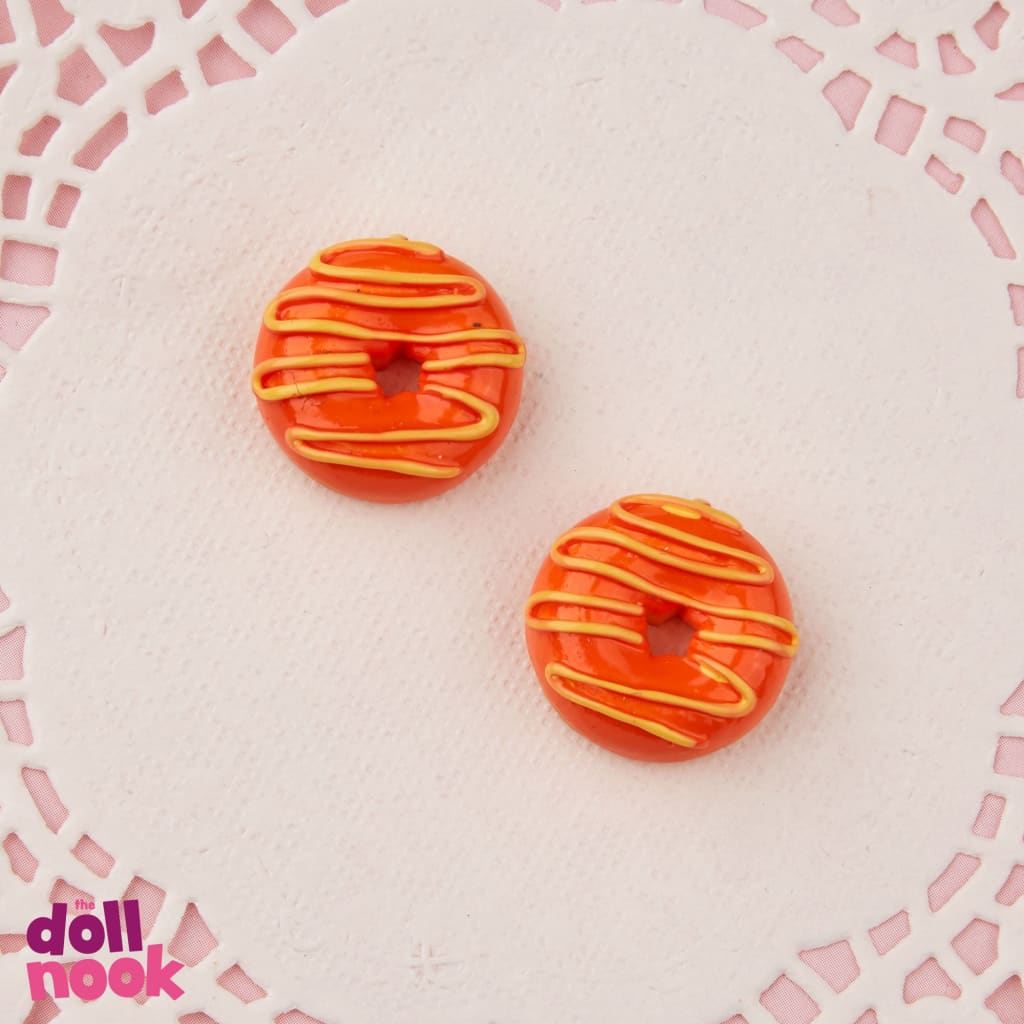 "2 resin orange glazed donuts with yellow glaze drizzled on top, 18"" doll food"
