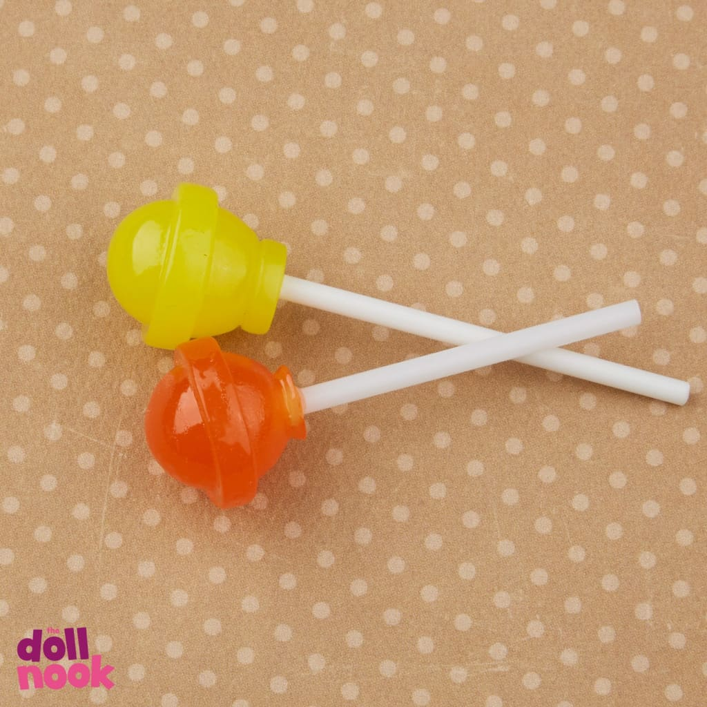 "resin dum dums, yellow and orange, 18"" doll food"