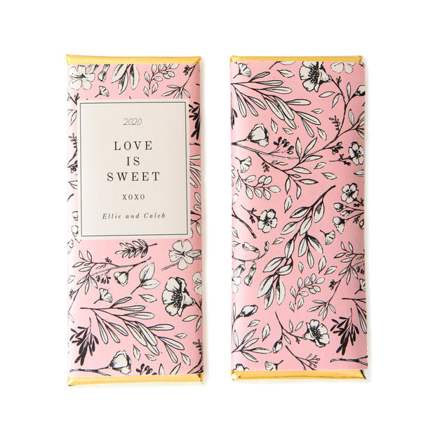 Romantic Black and White Floral Personalized Candy Bar Wrapper shown in Bubblegum Pink with Gold Foil and Love is Sweet Wording  | Custom Chocolate Bar Favor Packaging from Sweet Paper Shop