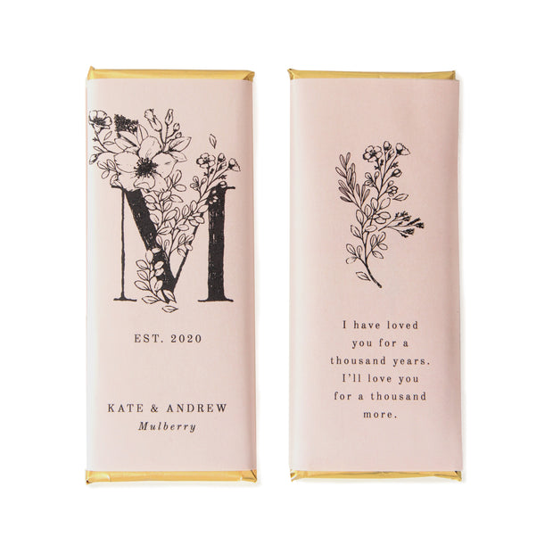 Wildflower Monogram Personalized Candy Bar Wrapper shown in Steel Wording and Whisper Pink Background with Gold Foil | Sweet Paper Shop