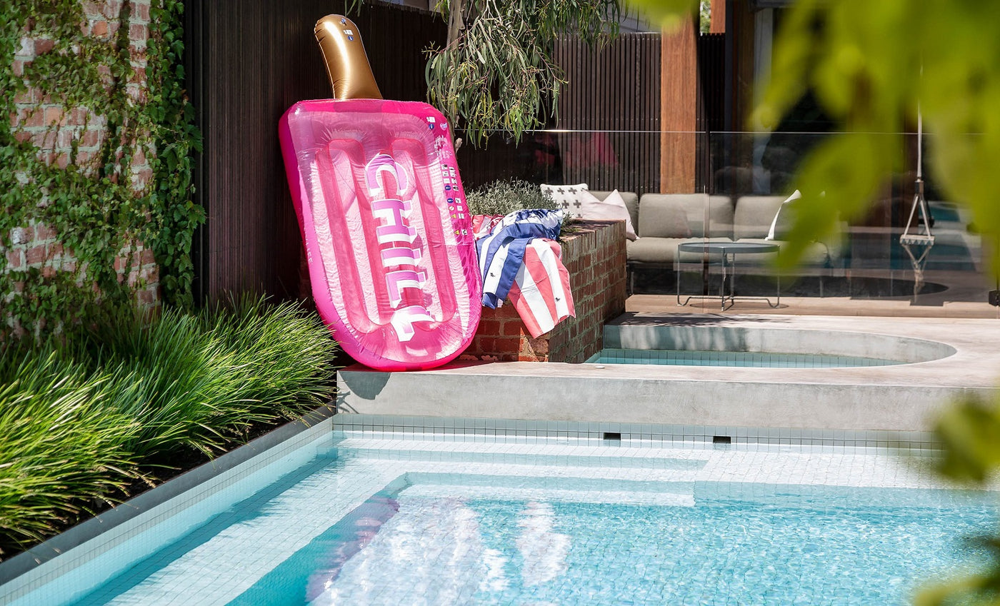 Laguna Lifestyle Poolside and Outdoor Lifestyle Accessories. Pool Floats and Pool Towels by a Laguna Pools Swimming Pool.