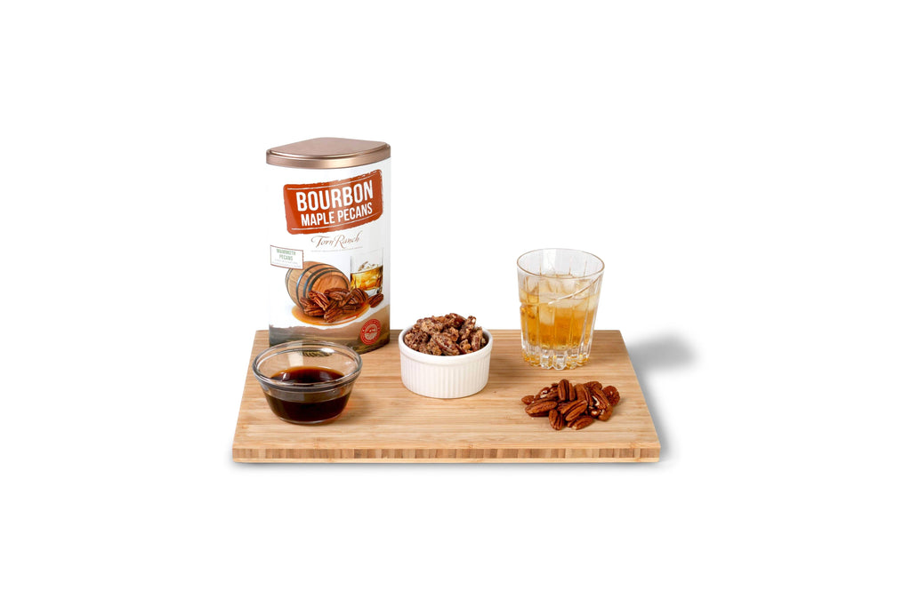 Copper Cocktail Nut Tin Collection Gourmet Nuts - Bourbon Maple Pecans and bourbon drink on wood tray