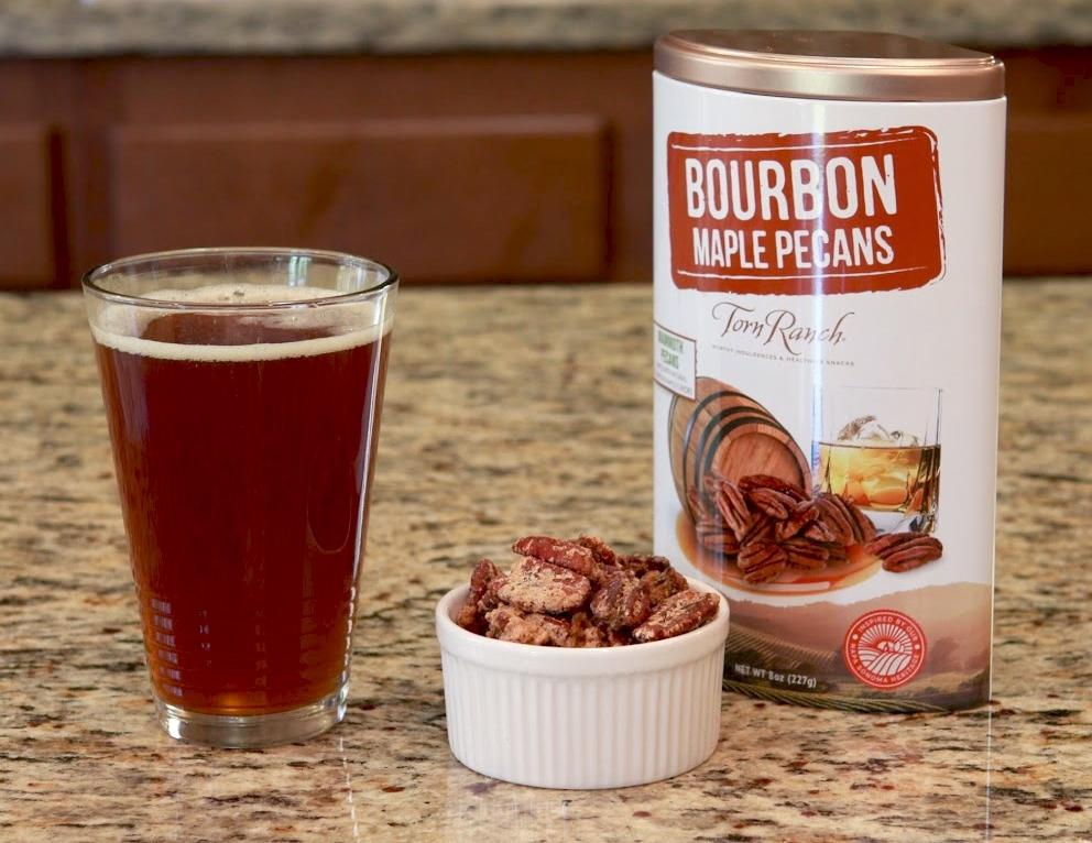 Copper Cocktail Nut Tin Collection Gourmet Nuts - Bourbon Maple Pecans in ramekin next to amber beer