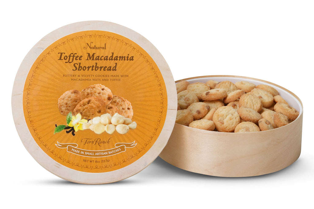 Toffee Macadamia Shortbread in Fresh Baked Cookies-Lid of cookies open next to full package