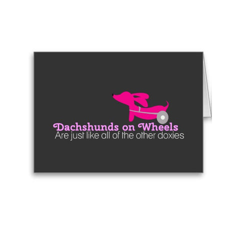 Dachshunds on wheels are just like the other doxies | Note Card