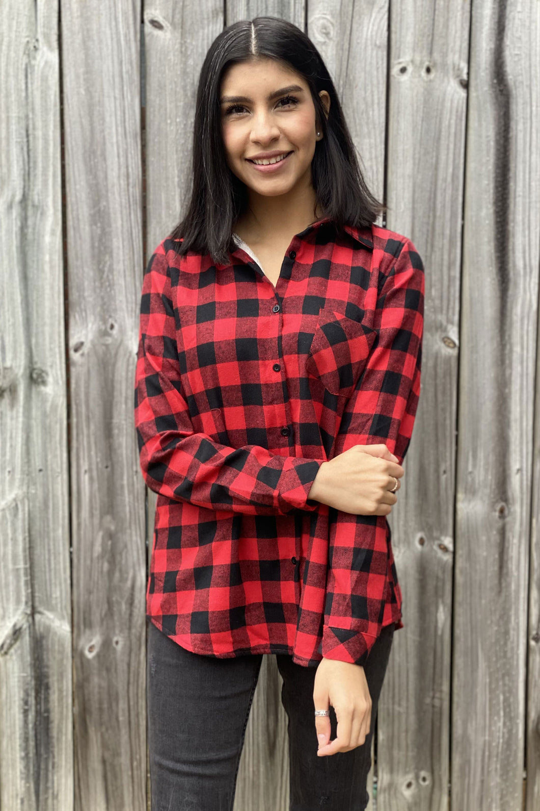 Our Home Sweet Home Flannel is your classic Buffalo Plaid Flannel with a twist. She has a red and black checkered plaid pattern. She features one front pocket and is Sherpa lined through the chest and back making her extra warm for the Winter. You can wear her by herself buttoned up or open with a tee or tank underneath. She is available in our Missy and Curvy Collections.