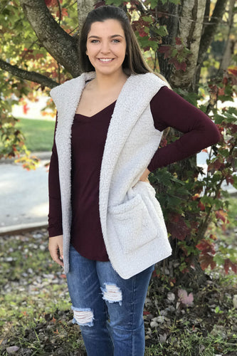 Our Take a Chance Sherpa Vest is a Fall necessity! She is unbelievably soft and warm. Her color is a neutral light grey that makes her wearable with every outfit. She features two pockets and a hood. She is cute thrown over our I've Got Plans Dress or our Fall in Love Blouse. We promise she will be your new favorite Fall closet item!