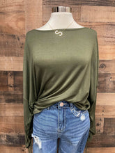 Load image into Gallery viewer, Want a top with a little bit more spunk and flare? Our Anything but Basic Top is meant for you! She is a super soft jersey knit material with gathered sleeves and an adjustable strap to control the length of the sleeves. She is definitely different but trendy and fabulous! Snag this adorable, trendy top today!