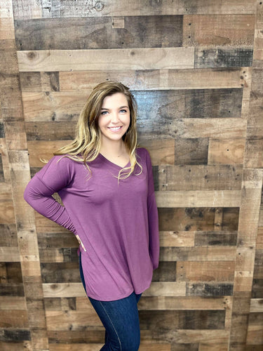 Everyone loves a good basic! Enjoy our Basically Beautiful top in a stunning eggplant color. Whether you are looking to layer her with a cardigan or even a vest this pop of color is perfect for your closet!