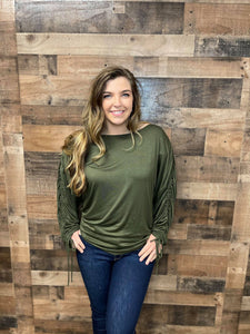 Want a top with a little bit more spunk and flare? Our Anything but Basic Top is meant for you! She is a super soft jersey knit material with gathered sleeves and an adjustable strap to control the length of the sleeves. She is definitely different but trendy and fabulous! Snag this adorable, trendy top today!