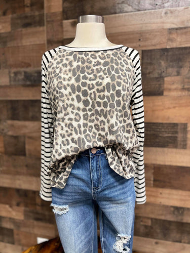 Our Hear me Roar Top is one of our favorites! She is a leopard print with black and white striped sleeves. She is the perfect blend of two prints and will be perfect for you! Whether style her up or dress her down she will be great for any occasion!