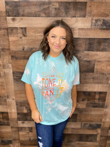 "Our Tan it Tone it Tee is a soft to the touch aqua bleach dyed tee. She features a printed design that reads, ""If you Can't Tone it Tan it.""   These shirts are hand dyed. Color, bleach, and dye pattern will vary on each shirt."