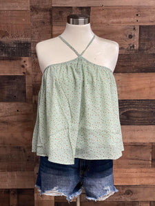 Our Star Light Top is perfect for spring. She is a beautiful hater crop top with mini stats printed all over her. She would be perfect paired with a pair of high waisted shorts!