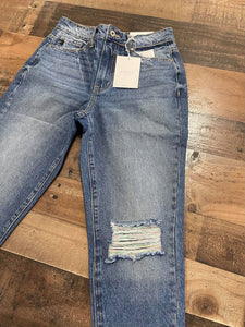 Who doesn't love a great pair of statement jeans? You are going to love our Set in Her Ways Kan Can jeans. They are a medium wash mom fit with distressing on the knee and frayed bottoms. The thing that really sets her apart from our other jeans is the rainbow threading mixed with the original white threading. You are going to love these jeans, Scoop them up today!