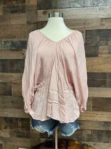Looking for a cute basic top with some sass, our Mauve Mania Top is just what you've been looking for. She is a 3/4 Sleeve Solid top with Batwing Sleeves. She features a Double Deep V Neck in the front and back with Shirring Neck/Waist Details. Scoop this cutie up today!