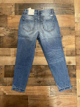 Load image into Gallery viewer, Who doesn't love a great pair of statement jeans? You are going to love our Set in Her Ways Kan Can jeans. They are a medium wash mom fit with distressing on the knee and frayed bottoms. The thing that really sets her apart from our other jeans is the rainbow threading mixed with the original white threading. You are going to love these jeans, Scoop them up today!