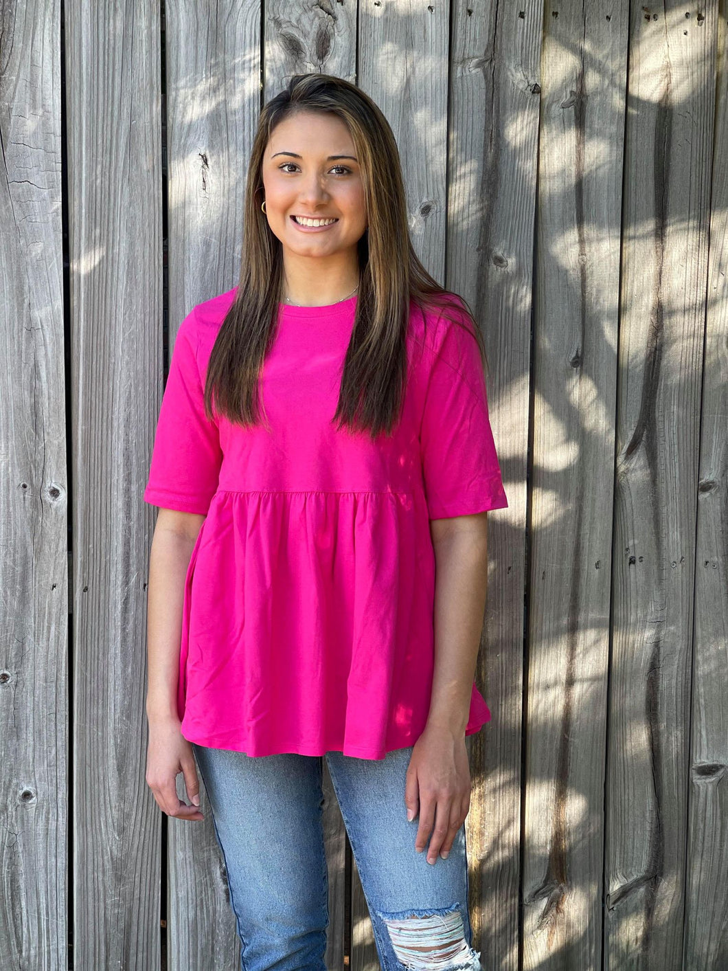 Sunny days are meant for out Brighter Days Ahead top. She is a beautiful half sleeve top with an empire waist and shirring top. You are sure going to feel fun, fabulous, and cute in this adorable top!