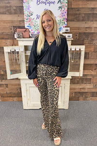 Stay wild in our Born to be Wild Pants. She is a leopard print flare style pant complete with a zipper closure and functional back pockets. With a live edge hem, she is the perfect statement piece to have in your closet. Pair her with your favorite graphic tee for a casual look or with a trendy crop top for a night out.