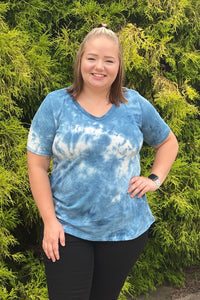 Our Tangled Up in Blue Top is a classic tie dye top. She has a U shaped neck and is made from a French Terry material. She is a denim blue tie dye that is perfect for Summer or Fall. She's a great trendy option for lounging around the house or going out to run errands.