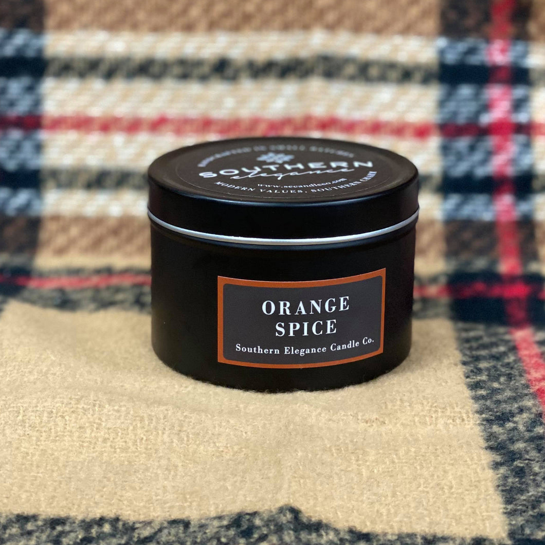 Our Orange Spice Black Tin Candle is a 6 oz hand poured soy candle made in Raeford, North Carolina. She has the scent of cloves and orange and is sure to be a favorite. She is a part of the Holiday Collection, so she won't be available long. She is made from a premium soy blend and has a burn time of 25 hours. Her container is a sleek black tin that can easily be used as a functional decor piece. She would also make the perfect gift for the candle lover in your life!