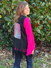 Load image into Gallery viewer, Our Wild West Vest is a great fringe piece that you NEED for your Closet. The silver studs around the arm holes and down the front are just a minor detail compared to the embroidered Cactus detail on the back! The multiple colors on the black suede makes this vest easily paired with multiple tops! Pair this vest with our Sassy Flare Top for a complete look!