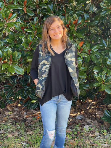 Lights, Camera, Action! Our In Action vest is a camo print with pockets. Pair this vest with flares or skinnies and create a basic but cute look. This Puff Vest is sure to keep you warm this season!