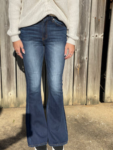 Enjoy your days in our Classic  Flirt and Flare Jeans. The dark wash paired with the flare bottoms make this jean such a classic look. Whether you are throwing on a tee or styling your favorite top these jeans are a must!