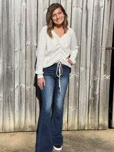 Load image into Gallery viewer, Enjoy your days in our Classic  Flirt and Flare Jeans. The dark wash paired with the flare bottoms make this jean such a classic look. Whether you are throwing on a tee or styling your favorite top these jeans are a must!