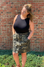 Load image into Gallery viewer, Our Dangerous in Camo Skirt is going to be a staple in your closet this Fall. She is a button up skirt with an elastic waistband. Her camo print is classic and a must have in your closet.