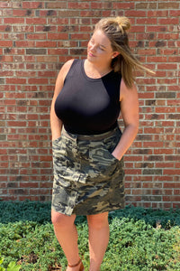 Our Dangerous in Camo Skirt is going to be a staple in your closet this Fall. She is a button up skirt with an elastic waistband. Her camo print is classic and a must have in your closet.