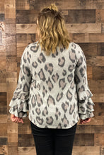 Load image into Gallery viewer, Our Spot Me Sweater is a super soft brushed knit sweater with a grey leopard print pattern. She has three tiered bell sleeves that are fun and flirty. Pair her with your favorite black jeans and booties for a cute Fall date night look.  Model is wearing a size 2X.