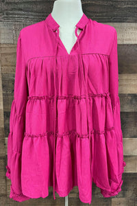 Looking for a Top that has a little bit of sass and a lot of bit of flare this is it! Our Hot Pink Sassy Flare top is a tiered top with drawstrings. Tie the neck up or leave the drawstrings loose, this top is sure to not disappoint! Pair her with our Wild West Vest to have a complete look.