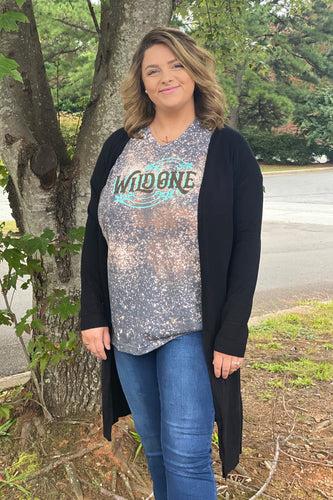 Our Comfy in Black Cardigan is just the staple piece you were looking for. She is an open front cardigan with a long body. She has high side slits and two pockets. She looks great thrown over a graphic tee or a skirt.  Model is wearing a size Large  Material Content: 50% Viscose/50% Nylon