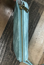 Load image into Gallery viewer, Our Take Me Away Crossbody is the perfect accessory to add a pop of color to your plain outfits. Her color is a distressed turquoise blue. She has 5 pockets within her one large zipper pouch. She features 6 slots to hold your cards, a zipper pouch perfect for holding change, and two basic pockets to hold your other necessities like keys, lipstick, lotion, etc. Her long crossbody strap is removable, and she comes with a shorter wristlet strap if you prefer to carry her that way. She would make a great gift f