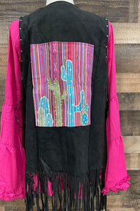 Our Wild West Vest is a great fringe piece that you NEED for your Closet. The silver studs around the arm holes and down the front are just a minor detail compared to the embroidered Cactus detail on the back! The multiple colors on the black suede makes this vest easily paired with multiple tops! Pair this vest with our Sassy Flare Top for a complete look!