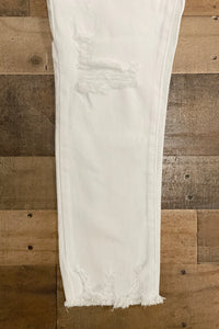 Our For the Love of White Jeans feature distressing and frayed hems on each leg.