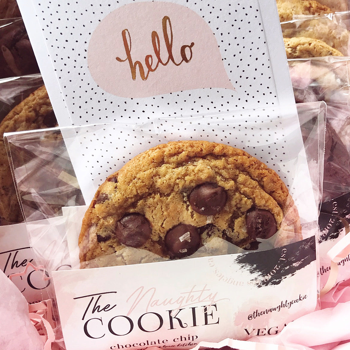 The Naughty Cookie Chocolate Chip Cookie in individual cookie sleeve with hello note card